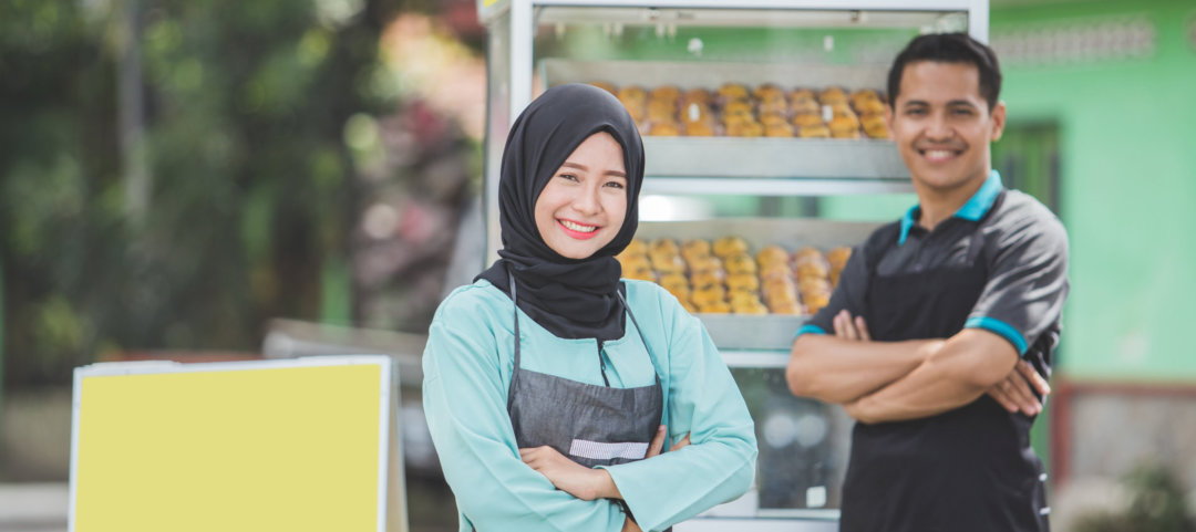 Young asian muslim small food stall owner