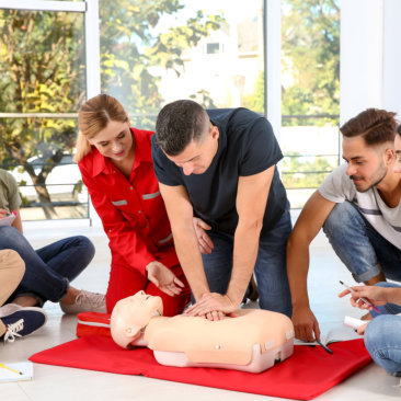 man instructor teaching the student how to cpr
